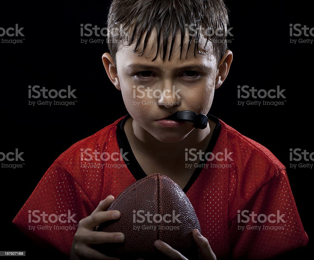Young Intense Football player stock photo
