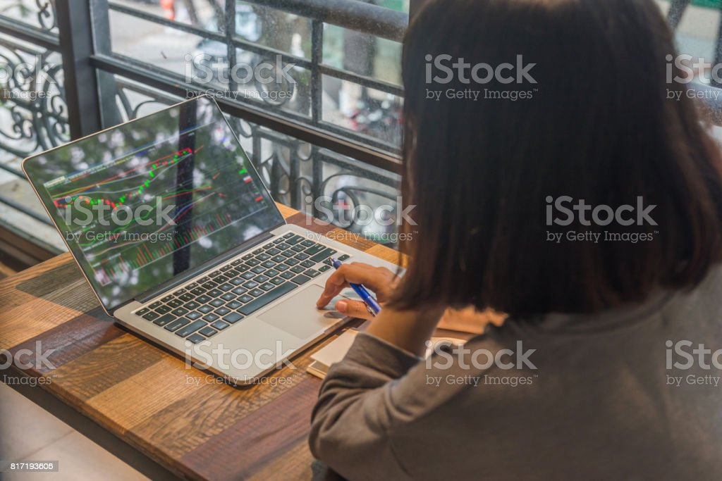 Young investor analyze the stock market on laptop stock photo