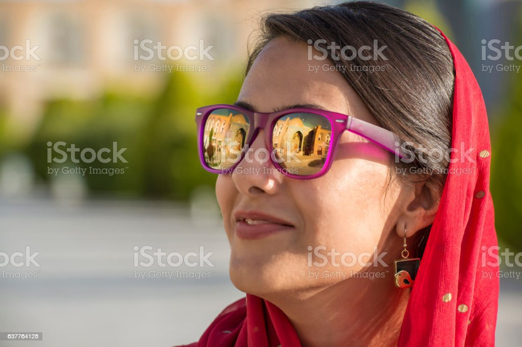 Young iranian woman with sunglasses and headscarf, Isfahan, Iran stock photo