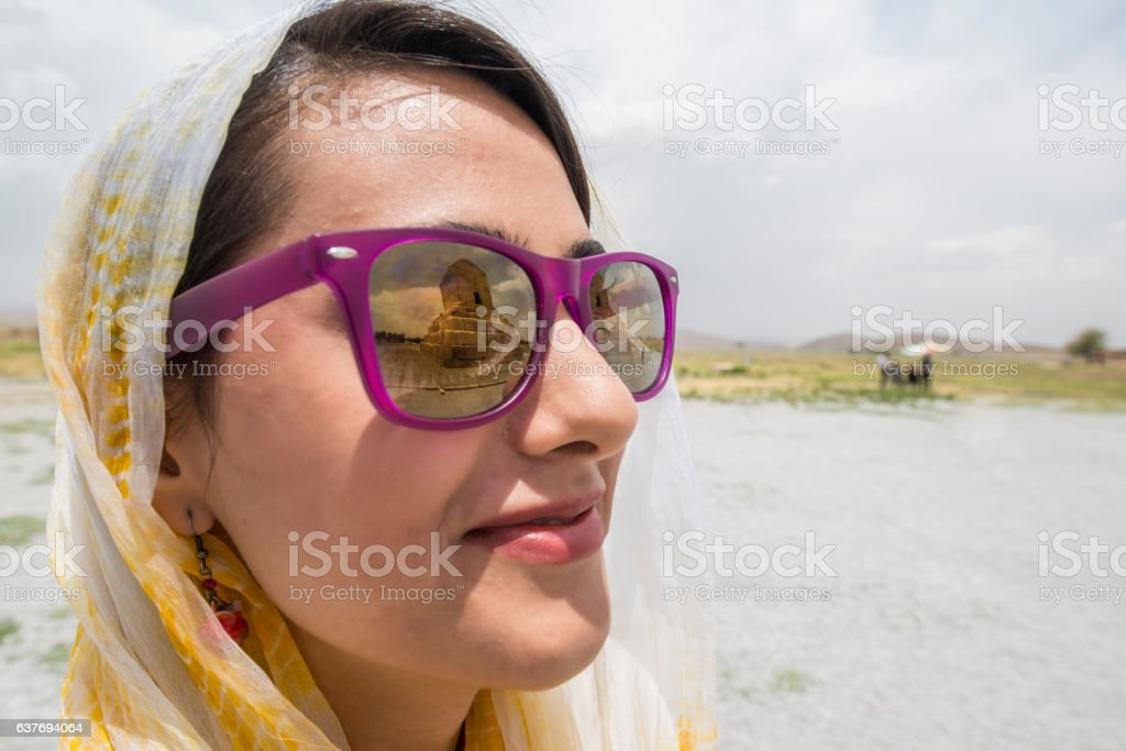 Young iranian woman with sunglasses and headscarf,  Pasargadae, Iran stock photo
