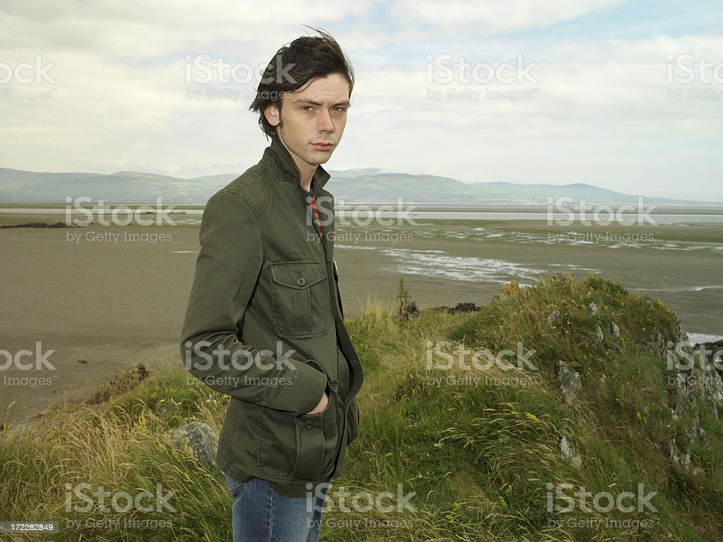 young irish man at the beach stock photo