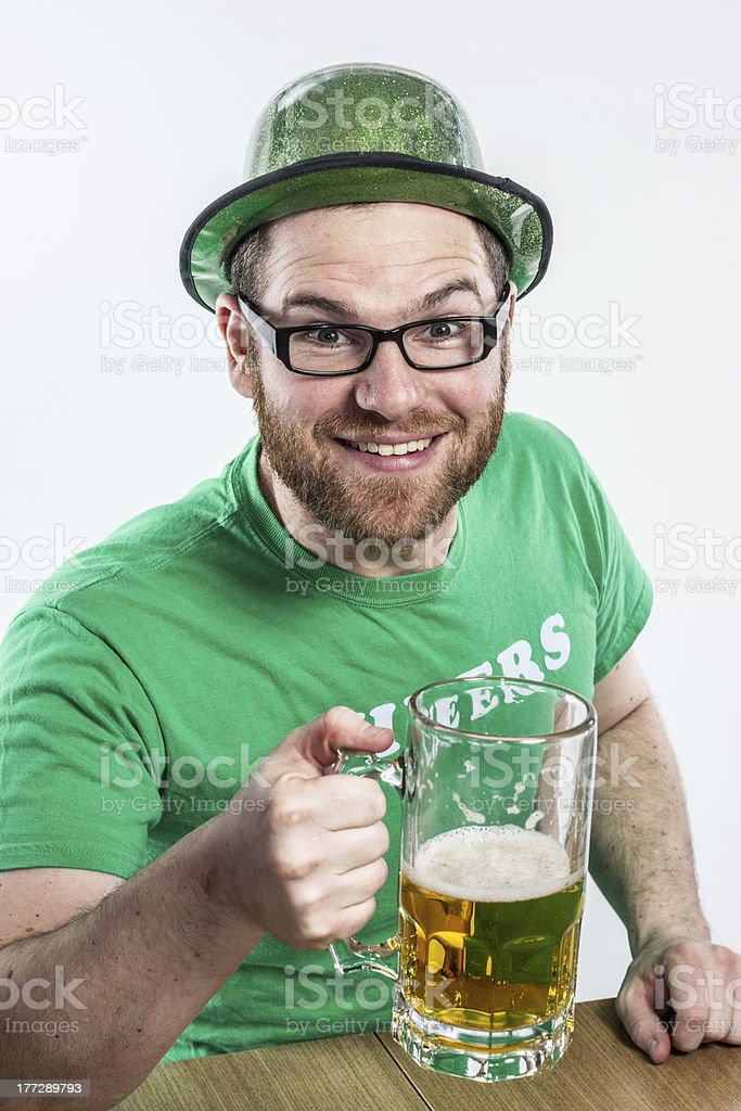 Young Irish man celebrating Saint Patrick's Day with beer royalty-free stock photo
