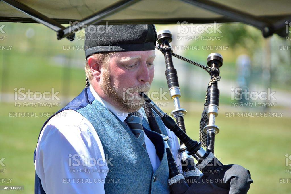 Young Irishman playing the Bagpipes stock photo