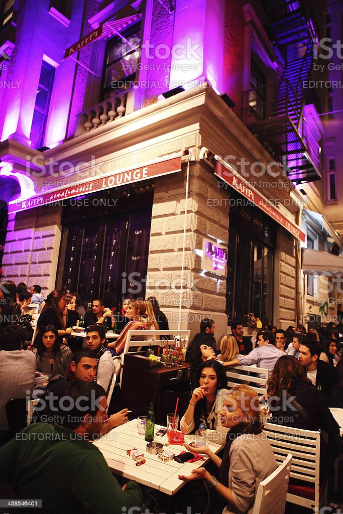 Young Istanbulites drinking and eating out at Pub, Istanbul royalty-free stock photo