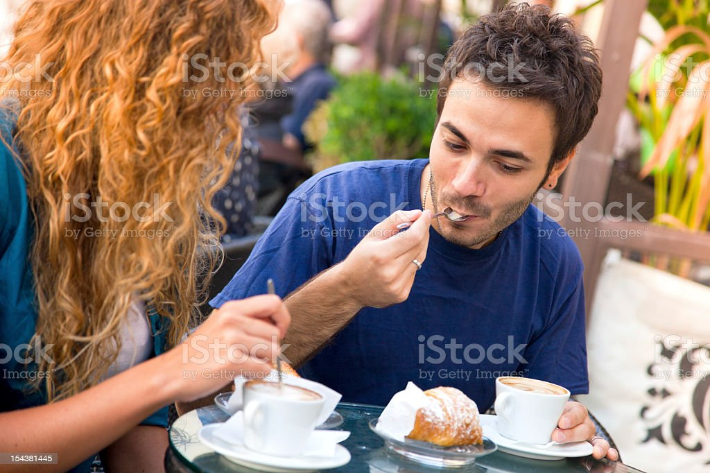 Young italian friends at cafe during breakfast royalty-free stock photo
