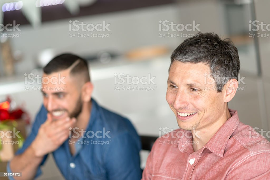 Young italian men in the kitchen stock photo