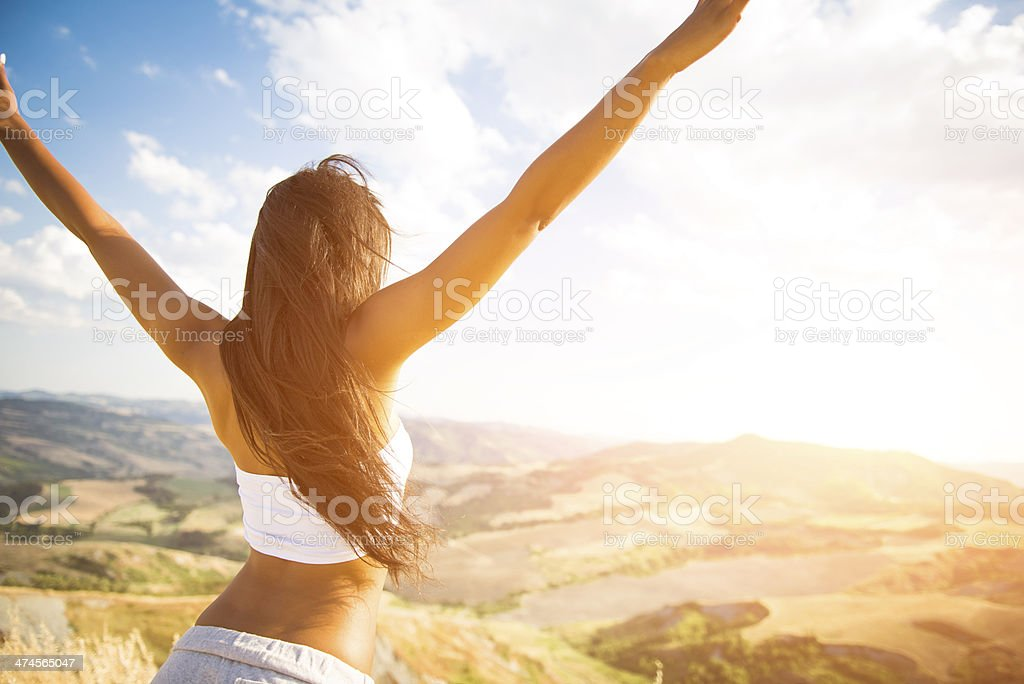 Young italian woman on top of the mountain royalty-free stock photo