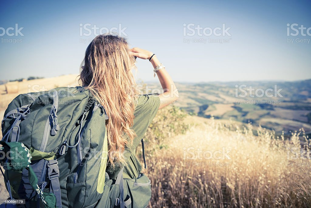 Young italian woman walking in the nature stock photo