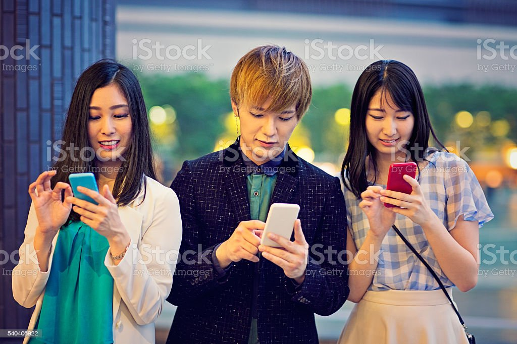 Young Japanese are are obssesed from their mobile phones stock photo