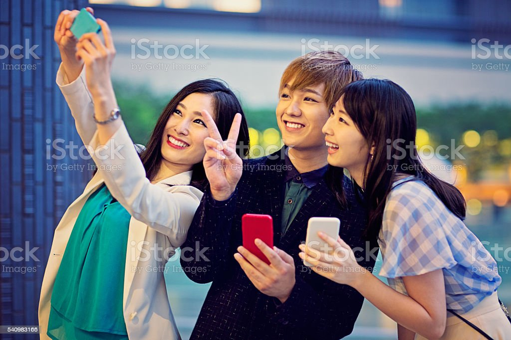 Young Japanese are taking selfie. stock photo