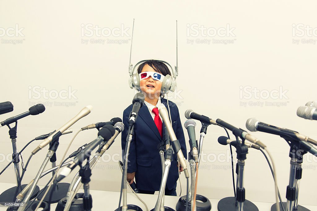Young Japanese Boy with Headset and Microphones stock photo