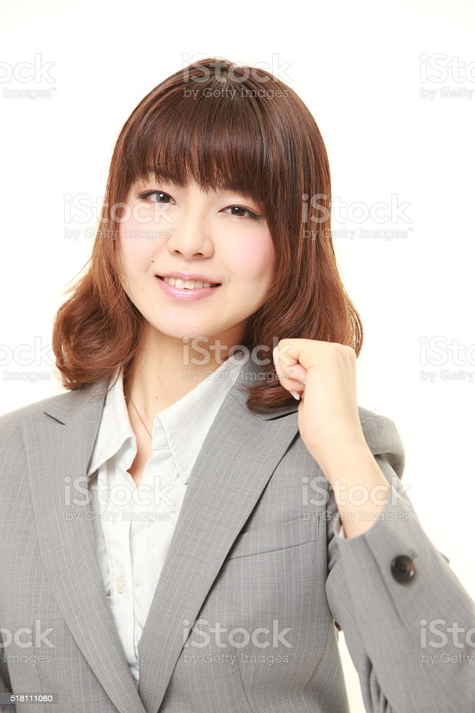 young Japanese businesswoman in a victory pose stock photo