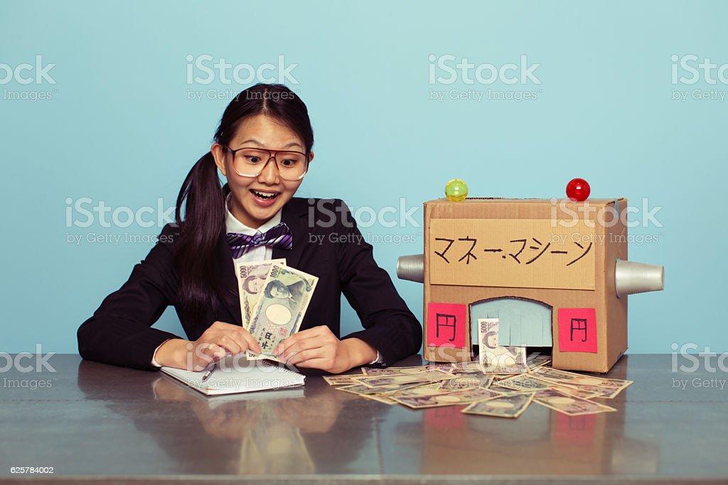 Young Japanese Businesswoman Makes Japanese Yen stock photo