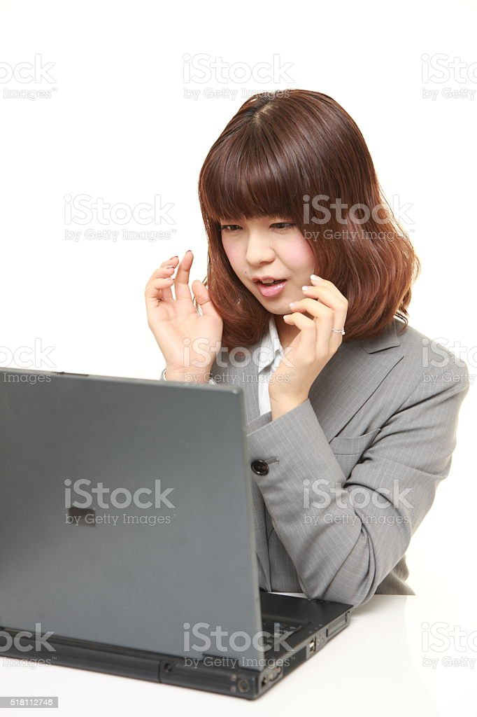 young Japanese businesswoman shocked stock photo