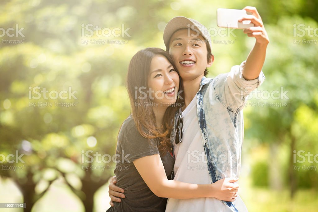 Young Japanese Couple Taking Sefie stock photo