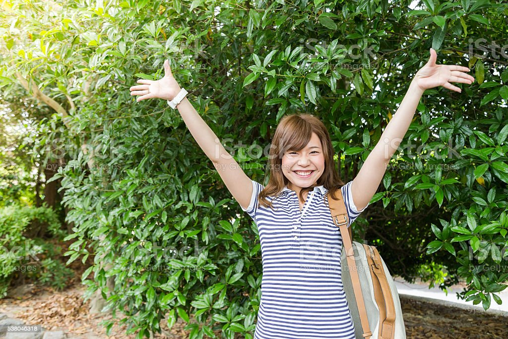Young Japanese Girl Overwhelmed with her Success stock photo