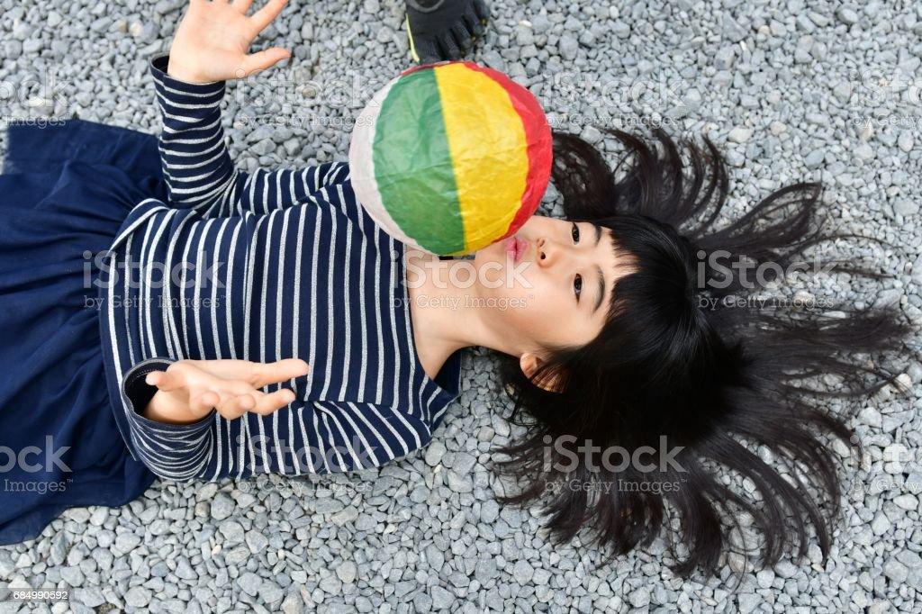 Young Japanese Girl Playing with Paper Balloon at Tofuku-ji, Kyoto stock photo