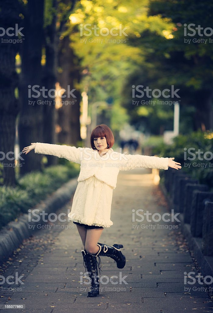 young japanese girl walking stock photo