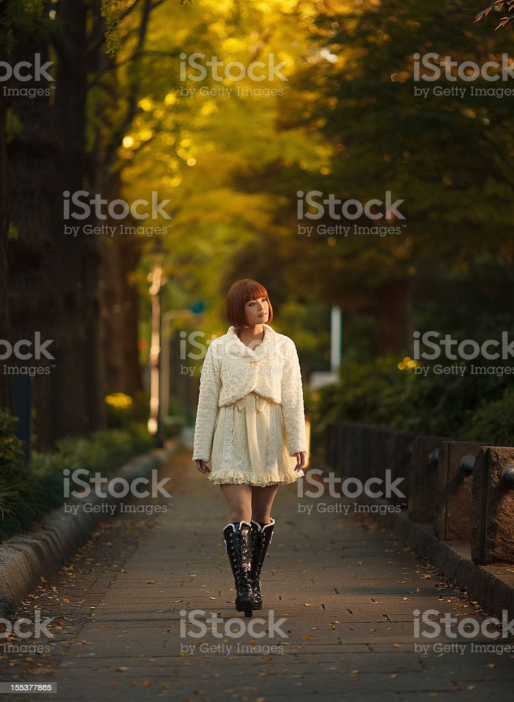 young japanese girl walking stock photo