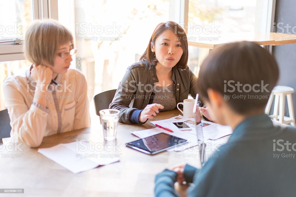 Young japanese ladies are on the bussiness meeting stock photo