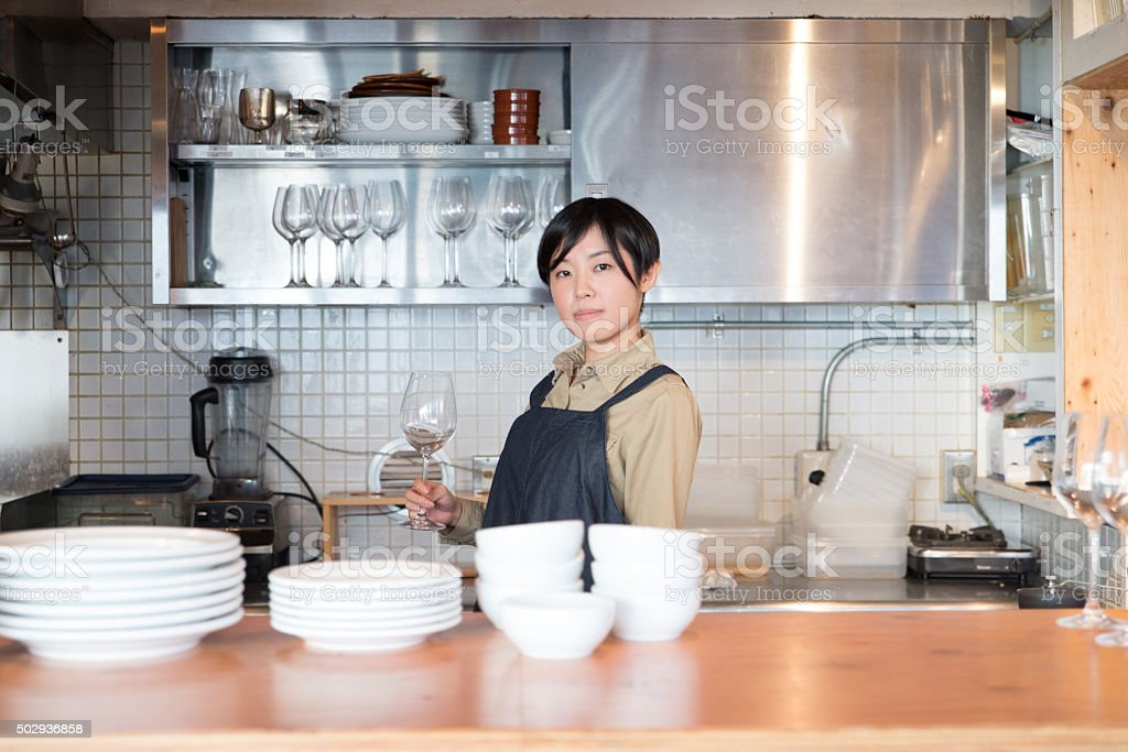 Young japanese lady woking at kitchen stock photo