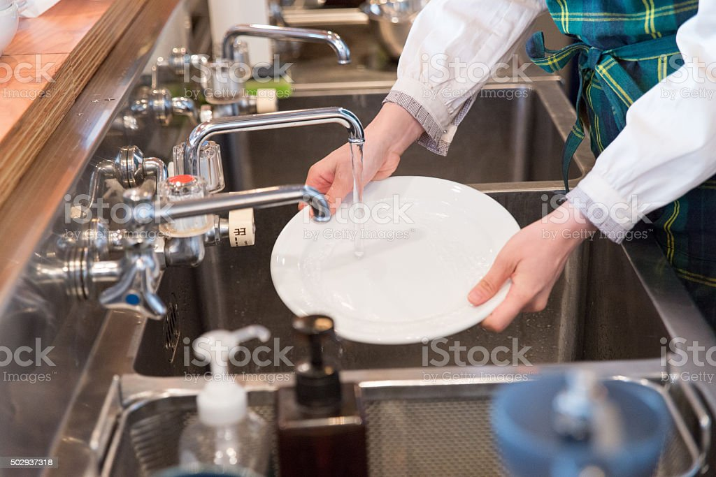 Young japanese lady working at kitchen stock photo