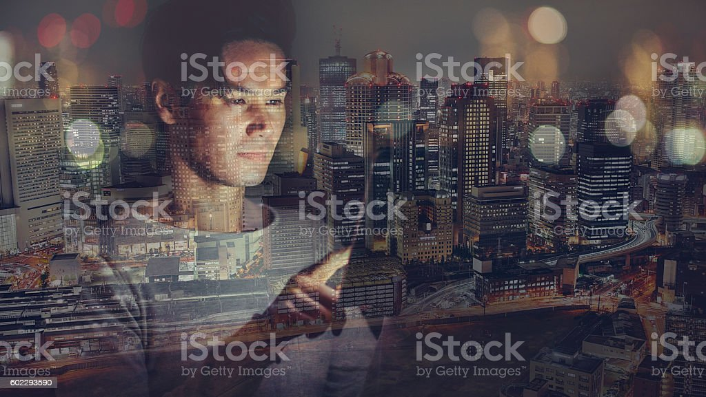 Young japanese man texting on the tablet stock photo