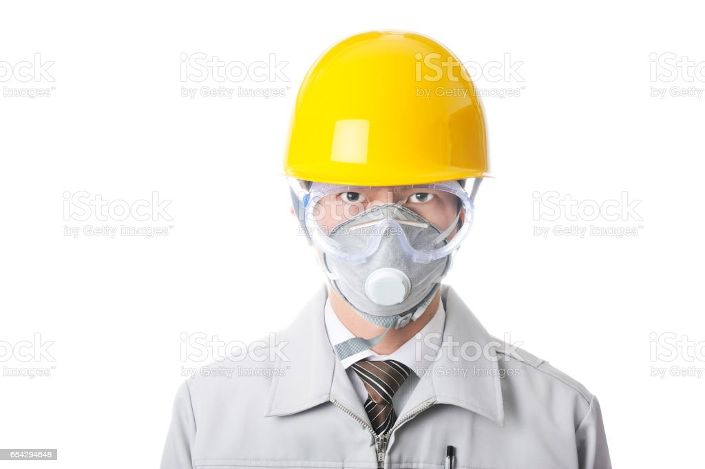 Young Japanese man wearing work clothes wearing face masks and helmets stock photo