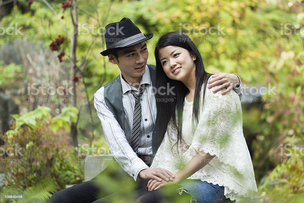 Young Japanese Romantic Couple Dating In The Park stock photo     iStock