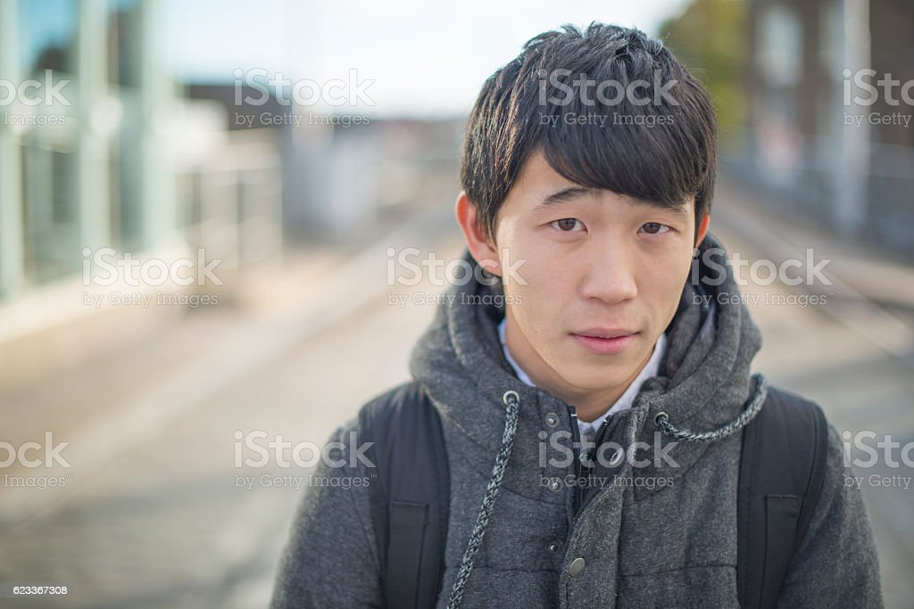 Young Japanese student looking to camera stock photo