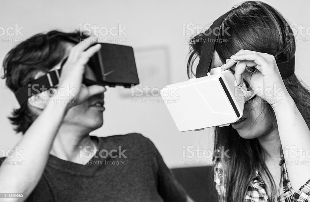 Young Japanese Students Enjoying Virtual Reality Console stock photo