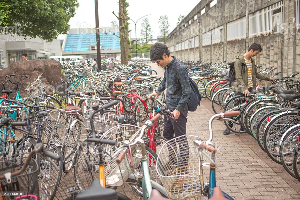 Young japanese students parking bcycles in kyoto japan stock photo