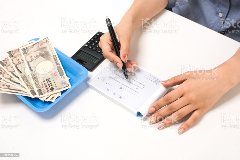 Young Japanese woman doing office work White background White background stock photo