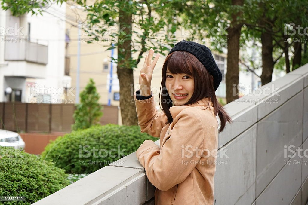 Young Japanese woman saying good-bye to her friend stock photo