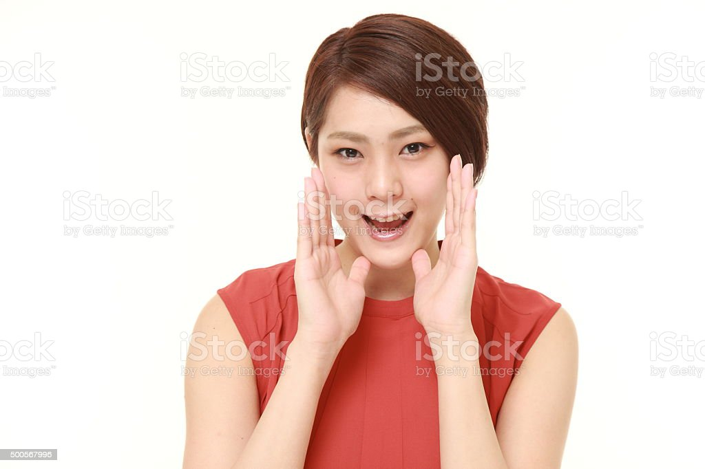 young Japanese woman shout something stock photo