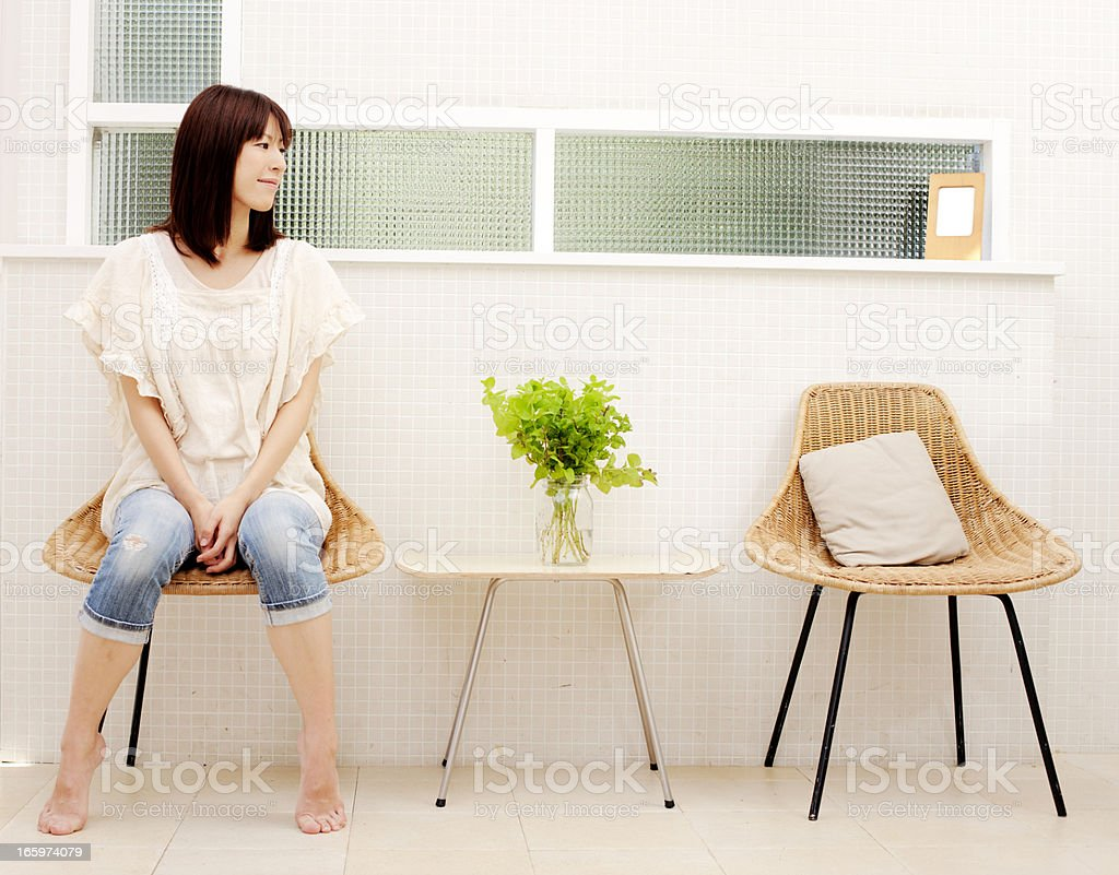 Young Japanese woman waiting royalty-free stock photo