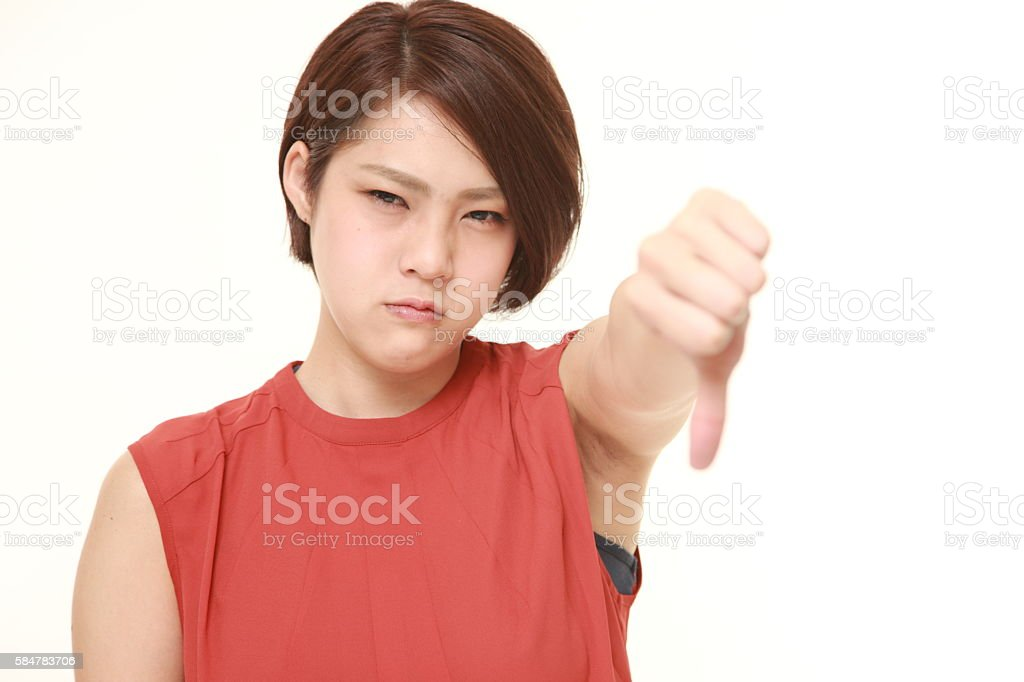 young Japanese woman with thumbs down gesture stock photo