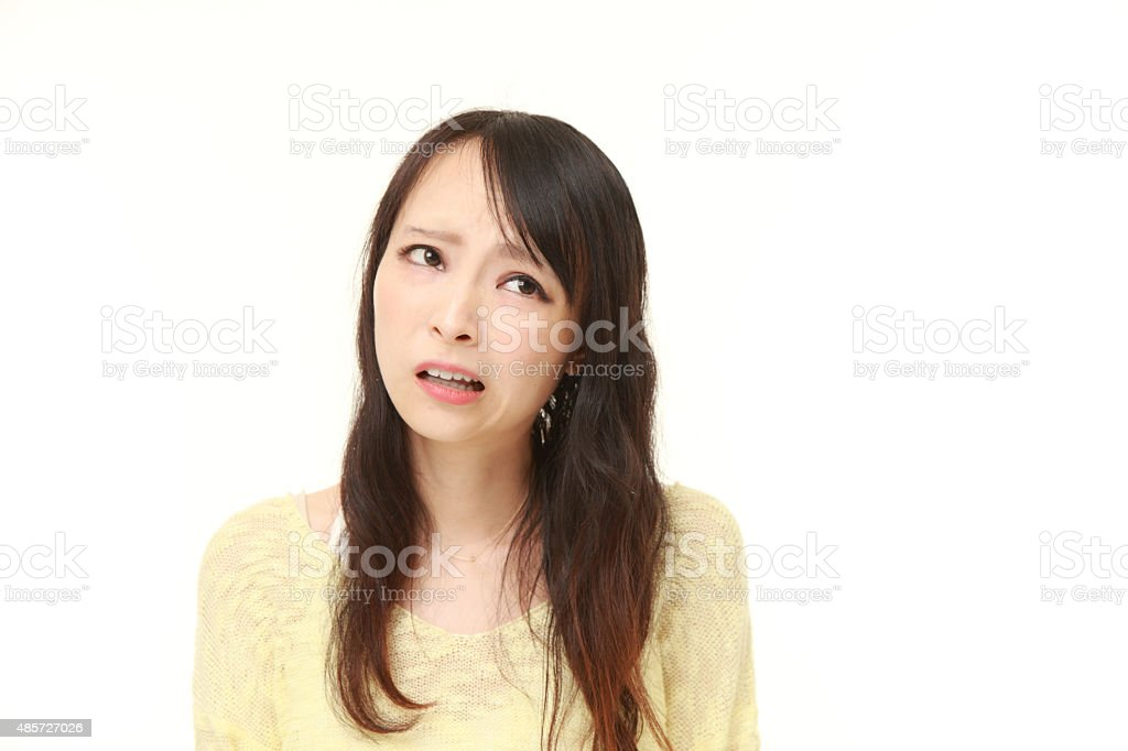 young Japanese woman worries about something stock photo