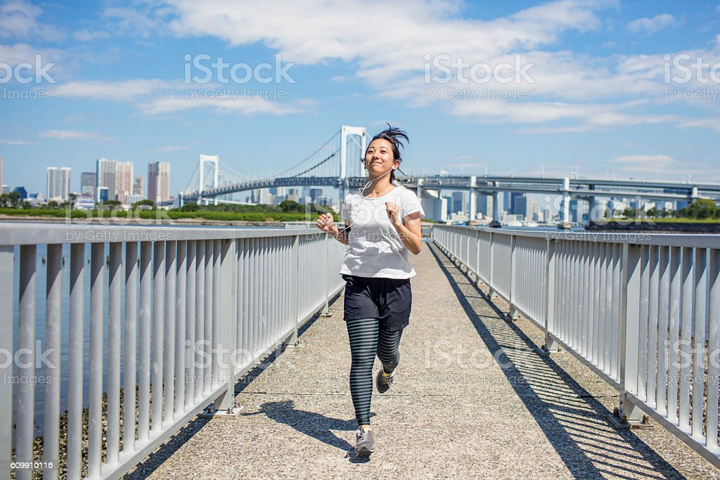 Young Japanese women running in Tokyo stock photo