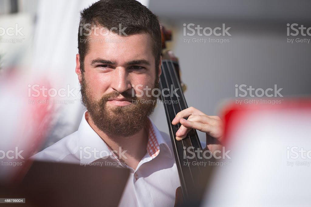 Young jazz musician playing bass stock photo