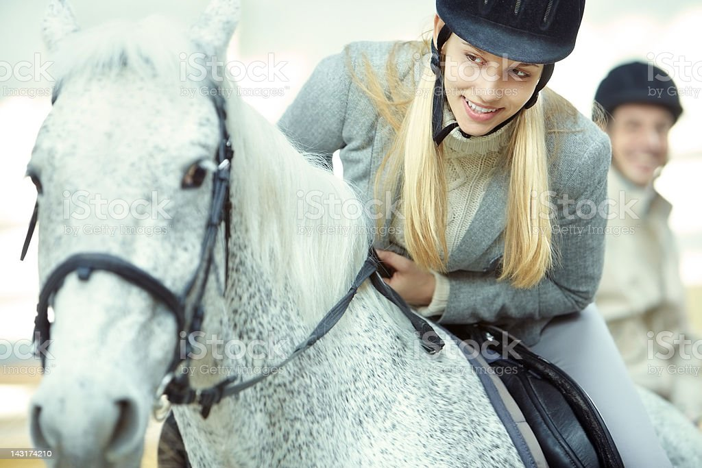 Young jockey and her nursling royalty-free stock photo