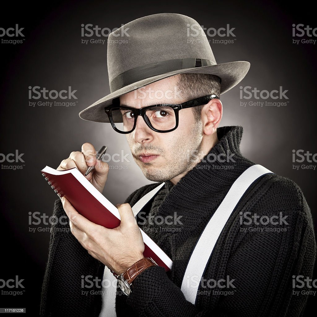 Young journalist with hat black background royalty-free stock photo