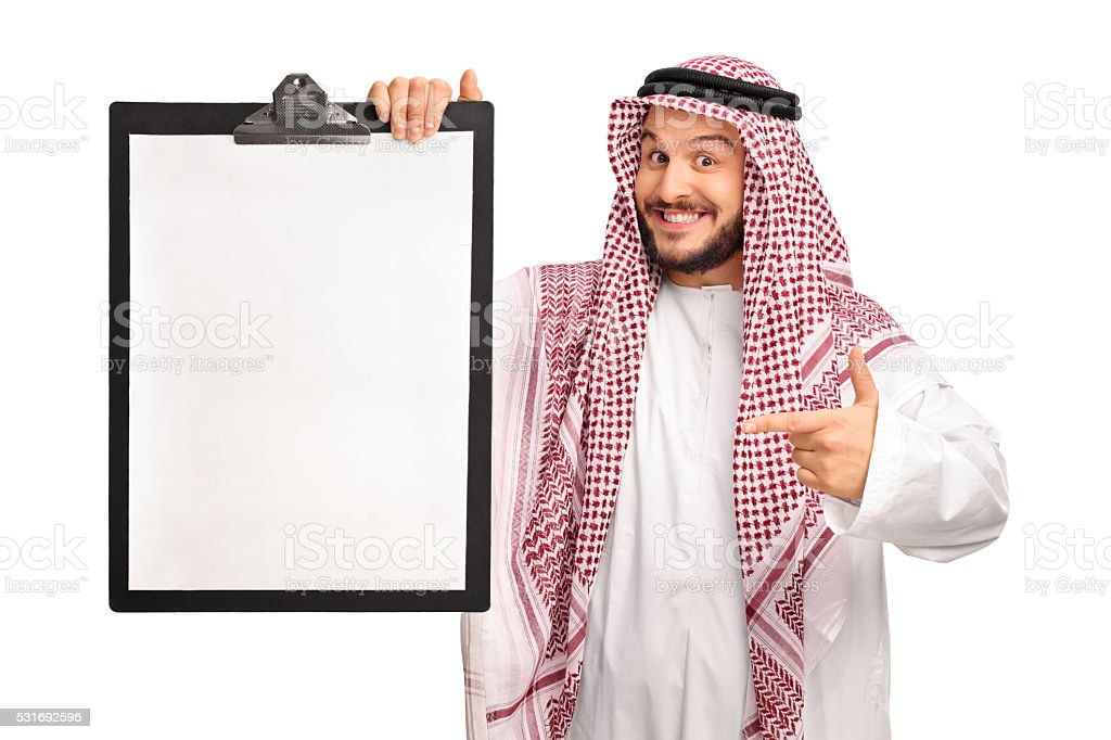 Young joyful Arab holding a clipboard stock photo