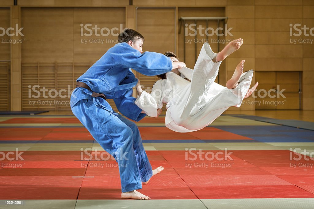 young judokas fighting royalty-free stock photo