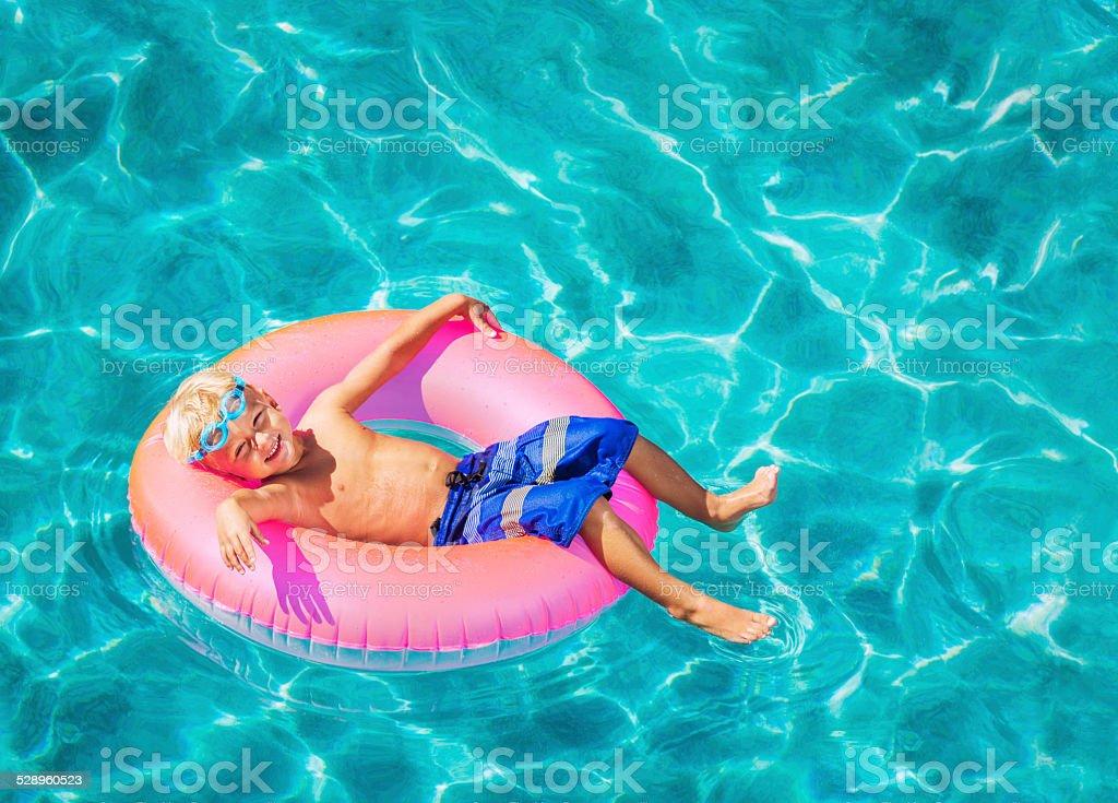 Young Kid Having Fun in Swimming Pool stock photo