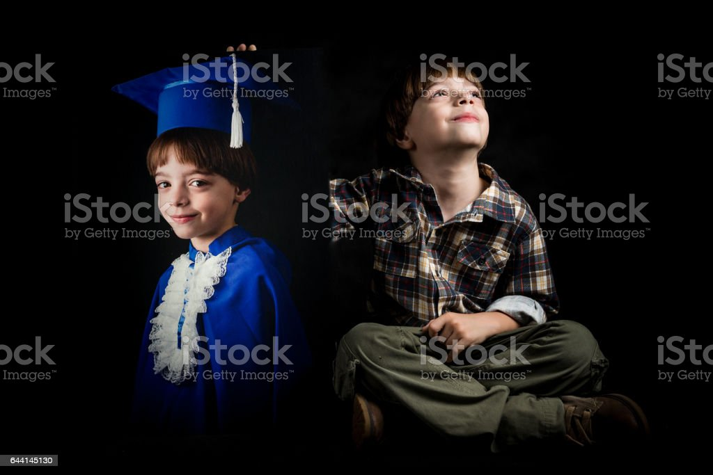 Young kid holding his picture of graduation scholarship stock photo