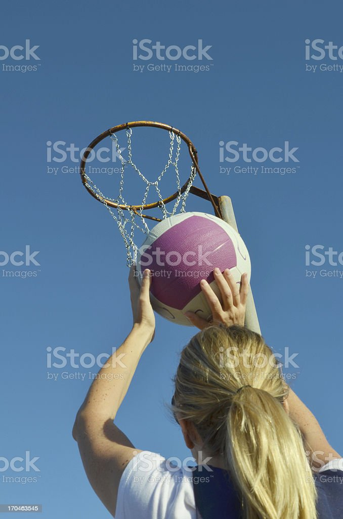 Young kid shooting a basketball into a netball royalty-free stock photo