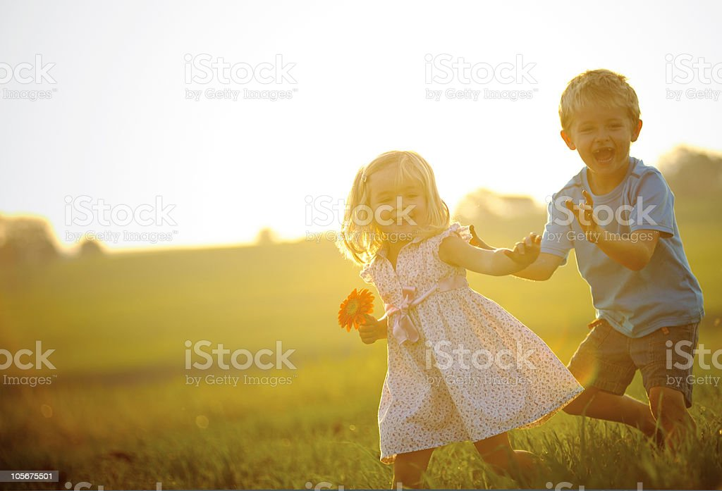 Young kids plaing at sunset stock photo