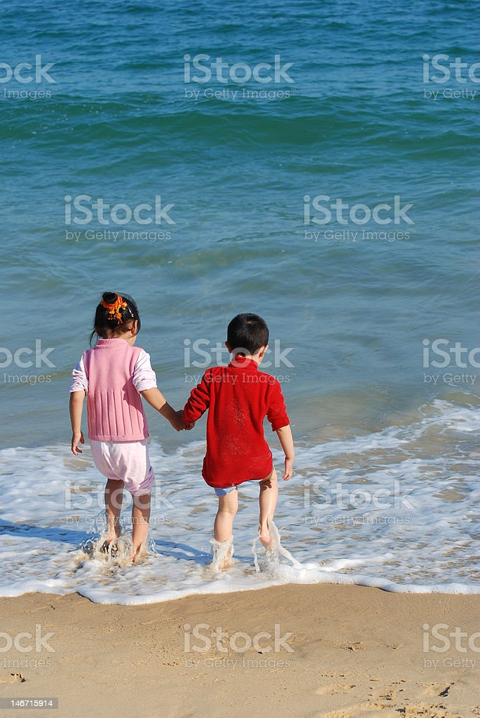 Young kids playing stock photo