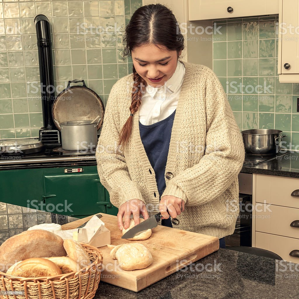 Young kinfolk woman preparing food in the kitchen - XV royalty-free stock photo